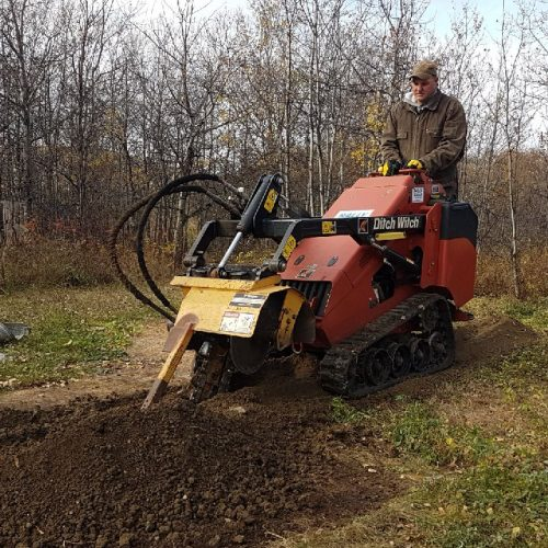 Mini Ditch Witch Trencher This self propelled unit is often used for smaller trenching projects. Notice how the digging components and gears are enclosed for safety.