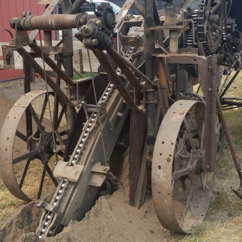 1946 Trenching Machine built by John Fraser of Huxley, AB. — at Pioneer Acres Museum.