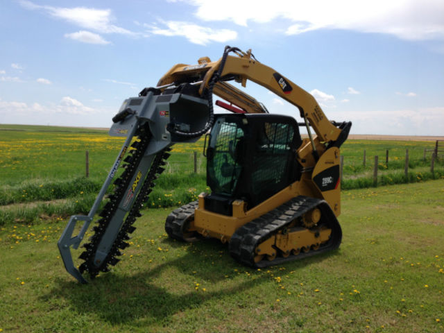 Skidsteer with Trencher Attachment